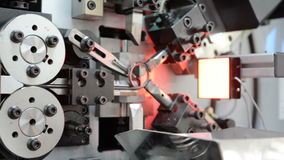 High-performance automatic machine for making steel springs. Linear panning from right to left stock video footage