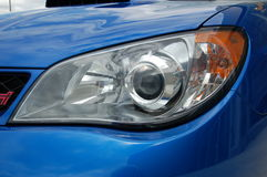 High performance eye. Intricate detail and symmetry of the modern performance automobile headlights Stock Photos
