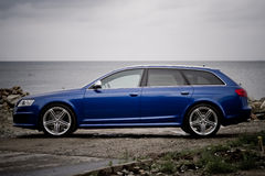 High performance family estate car. Side view of a high performance family estate car on a seashore stock images