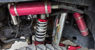 A high performance suspension system for an off-road vehicle. A sturdy jeep with heavy-duty springs used for extreme driving adventures Royalty Free Stock Photos