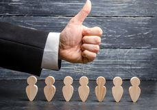 High performance team. The concept of teamwork and trust. The success of business people. The leader is pleased with the workers a royalty free stock image