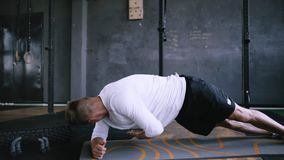 Intermediate no equipmetn exersize to endurance, sit ups. stock video footage