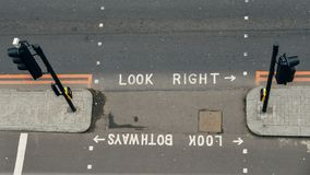 High perspective view of empty pedestrian crossing in the City of London. Iconic look left and look right signs painted stock photography