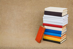 High pile old books and textbooks on canvas. The high pile of old books and textbooks on the background of the canvas Royalty Free Stock Photography