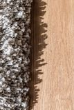 High pile rug. Braided threads. Twisted ropes. Gray carpet stock photos