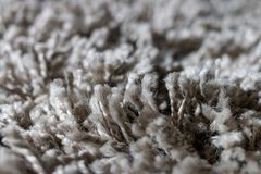 High pile rug. Braided threads. Twisted ropes. Gray carpet royalty free stock images