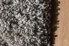 High pile rug. Braided threads. Twisted ropes. Gray carpet stock photography