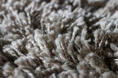 High pile rug. Braided threads. Twisted ropes. Gray carpet stock image