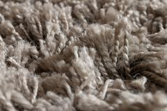 High pile rug. Braided threads. Twisted ropes. Gray carpet royalty free stock photography