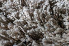 High pile rug. Braided threads. Twisted ropes. Gray carpet royalty free stock photos