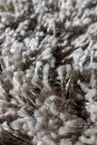 High pile rug. Braided threads. Twisted ropes. Gray carpet royalty free stock photo