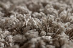 High pile rug. Braided threads. Twisted ropes. Gray carpet stock images