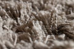 High pile rug. Braided threads. Twisted ropes. Gray carpet stock photo