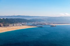 From the high point of the Nazare we can see the beach the sea and the village Nazare, Portugal royalty free stock images