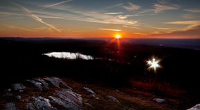 High Point State Park in late autumn with starburst sunset and spotlights Stock Photography