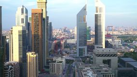 Modern city skyline. High point view of Dubai Financial District skyline and The Future Museum construction site stock video footage