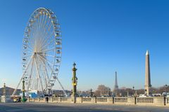 High points of Paris. Big wheel, Eiffel Tower and Egyptian obelisk with breathtaking blue sky royalty free stock photos