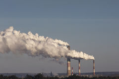 High pollution from coal power plant. Smoking chimney. Royalty Free Stock Photo