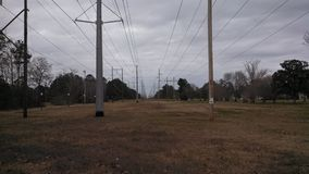 High power electrical lines. A view of the high power electrical lines that supply electricity to Charleston AFB in CHarleston, South Carolina, USA stock photos