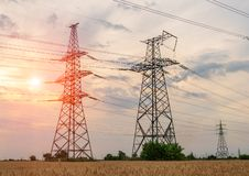 High power electricity poles in urban area. Energy supply, distribution of energy, transmitting energy, energy transmission, high Royalty Free Stock Images