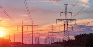 High power electricity poles in urban area. Energy supply, distribution of energy, transmitting energy, energy transmission, high. Voltage supply concept photo royalty free stock photography
