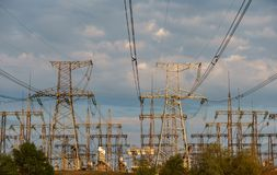 High power electricity poles in urban area. Energy supply, distribution of energy, transmitting energy, energy transmission, high. Voltage supply concept photo stock image