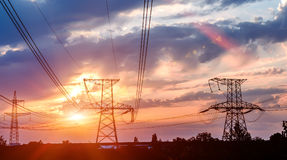 High power electricity poles in urban area. royalty free stock photo