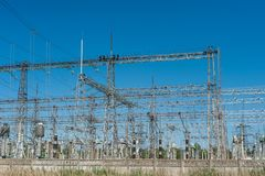 High power electricity poles in urban area. Energy electricity transmission, high voltage supply. Power Lines Stock Photo