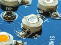 High power LED installed on blue circuit board Stock Photos