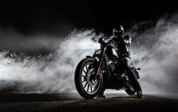 High power motorcycle chopper with man rider at night Royalty Free Stock Images