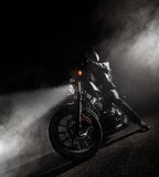 High power motorcycle chopper at night. Smoke effect on dark background stock images