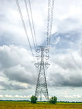 High power pylons and natural green with clear skies. High power pylons and natural green with bright sky and sun stock images