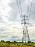 High power pylons and natural green with clear skies. High power pylons and natural green with bright sky and sun royalty free stock photography