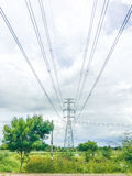 High power pylons and natural green with clear skies. High power pylons and natural green with bright sky and sun stock photos