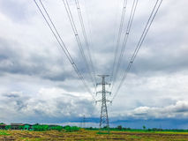 High power pylons and natural green with clear skies. High power pylons and natural green with bright sky and sun royalty free stock photo