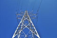 High power tower pole against blue sky Royalty Free Stock Images