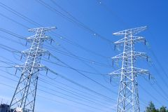 High power transmission towers. The power plant must raise the voltage to the high voltage power to carry the electricity in a long distance. The dangerous high stock image