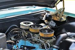 High powered 421 cubic inch engine. 421 CI engine with three two -barrel carbs commonly known as a six-pack Stock Images