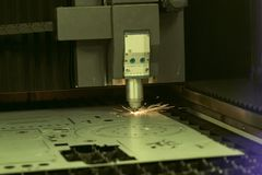 High precision CNC laser welding metal sheet. High speed cutting; laser welding; laser cutting technology; laser welding machine royalty free stock photos