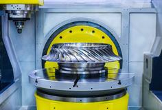 High-precision CNC machine processes steel turbine wheel. Stock Photos