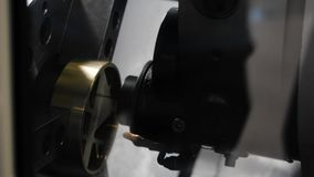 High-precision metal processing on the machine. Media. CNC machine processes metal detail. Close-up of the metal. Workpiece processing on the latest machine stock video footage