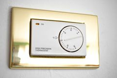 High precision thermostat. On a white wall Royalty Free Stock Images