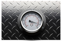 High pressure. Pressure gauge mounted on textured surface Royalty Free Stock Image