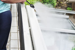 High Pressure Cleaning glass roof Stock Photography