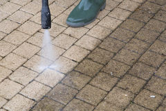 High Pressure Cleaning - 07. Outdoor floor cleaning with high pressure water jet Stock Image