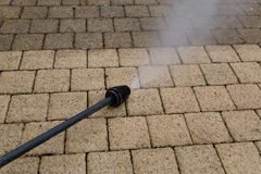 High Pressure Cleaning. Outdoor floor cleaning with high pressure water jet Royalty Free Stock Photos