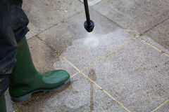 High Pressure Cleaning. Outdoor floor cleaning with high pressure water jet Royalty Free Stock Photo