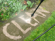 High pressure cleaning. High pressure water cleaning garden floor Stock Images