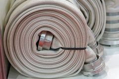 Fire hose. High pressure fire hose in coil Royalty Free Stock Images