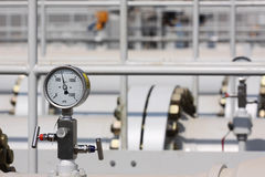 High Pressure Gauge on process piping Stock Photo